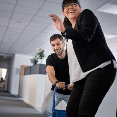 man and woman having fun at work